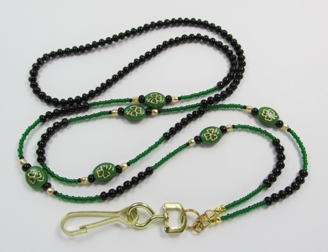 Black, Green and Gold Badge Holder with Green Glass Shamrock Beads