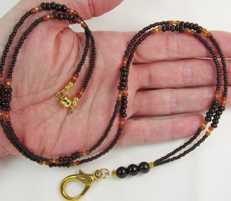 Brown and  Gold glass beaded badge holder necklace with magnetic clasp