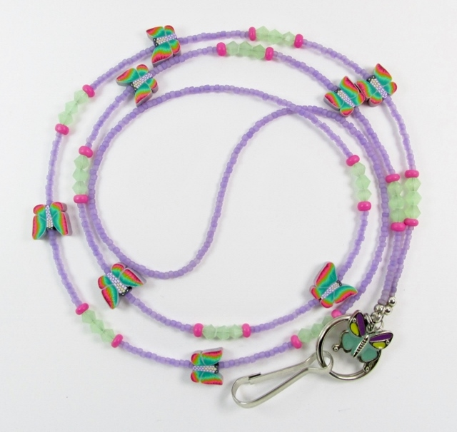 Purple, green and pink  glass-beaded lanyard with multi colored fimo butterfly beads