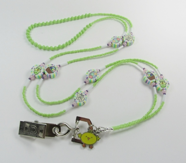 Mint green, white and purple beaded lanyard with fimo easter beads