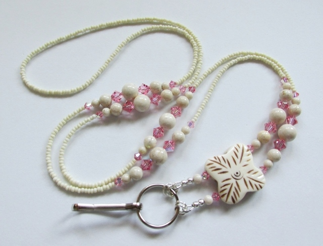 Pink Swarovski  and Fossil Beads badge holder necklace