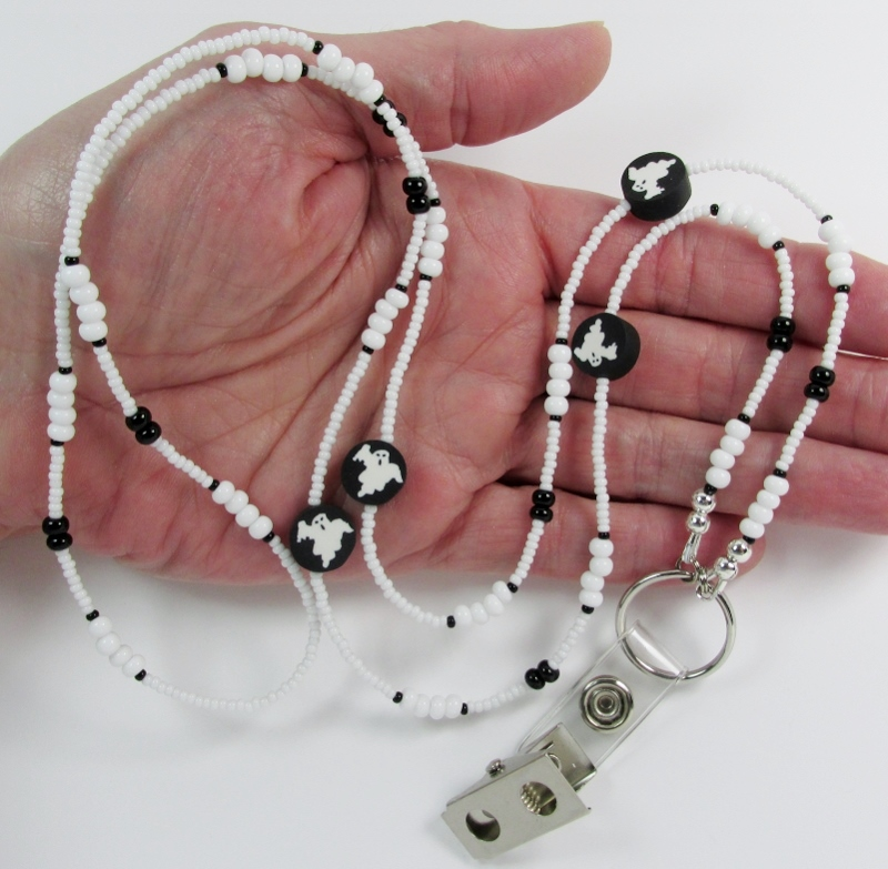 White and black  glass beaded lanyard with polymer fimo ghost beads