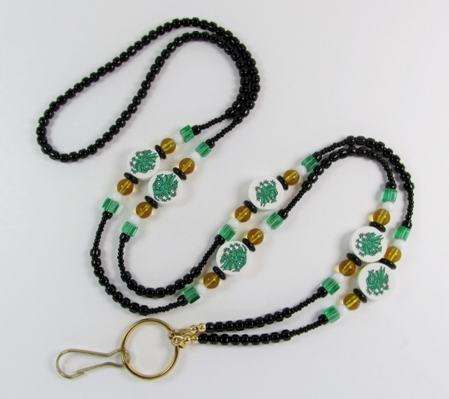 Black, white, green  and topaz glass beaded lanyard with fimo green dragon beads