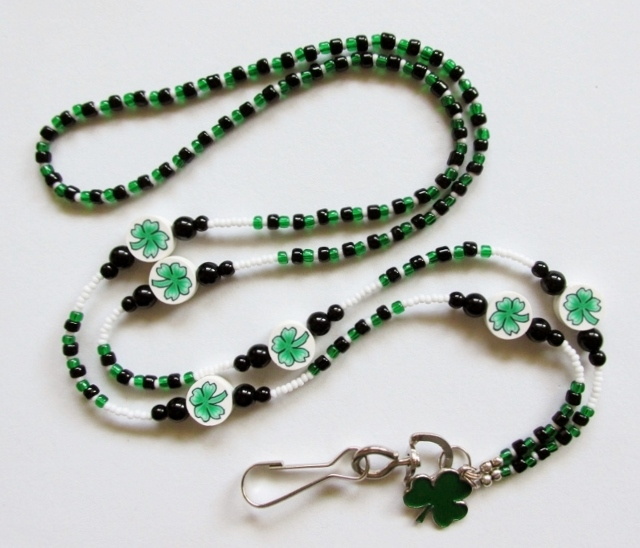 Black, White and Green Lanyard with Shamrock Beads and Enameled Charm
