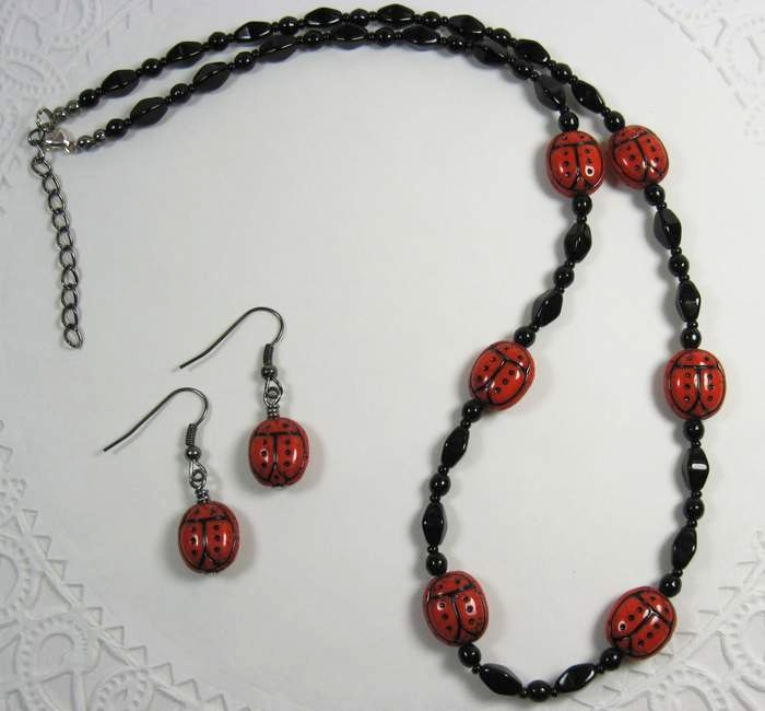 Black beaded necklace  with ladybug beads and matching earrings