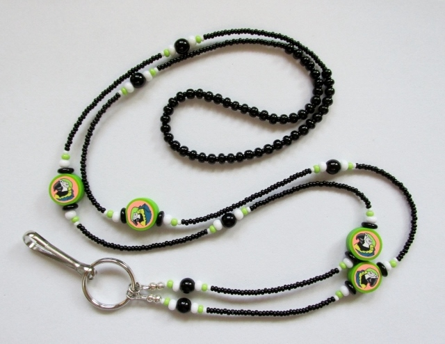 Black, green and  white glass beaded lanyard with fimo parrot beads