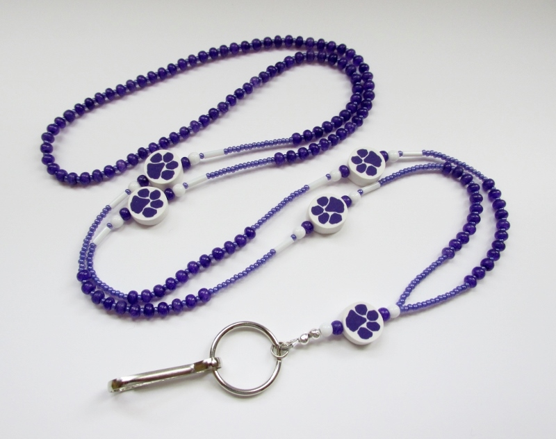Purple and white glass beaded ID badge holder necklace with purple paw print beads