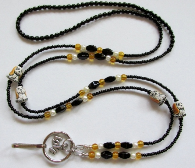 Black, white and  topaz glass beaded lanyard with ceramic puppy beads
