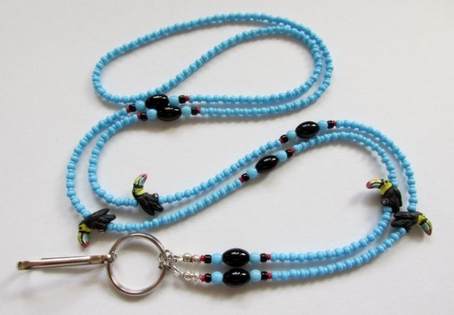 Blue, black and  red glass beaded lanyard with ceramic toucan beads