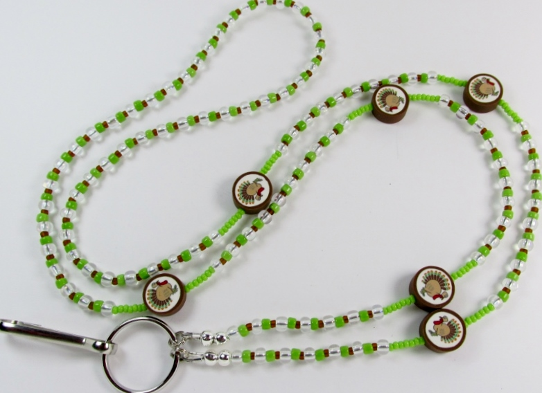 Green, Clear  and Brown beaded lanyard with fimo turkey beads